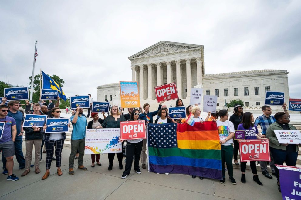PHOTO: Supporters of the American Civil Liberties Union and other progressive groups gather to protest the Supreme Court decision to side with a Colorado baker who refused to bake a cake for a same sex couple in Colorado in Washington, DC, June 4, 2018.