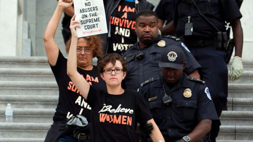 Demonstrators are arrested on the steps of the Capitol as they protest the appointment of Supreme Court nominee Brett Kavanaugh, Oct. 6, 2018.