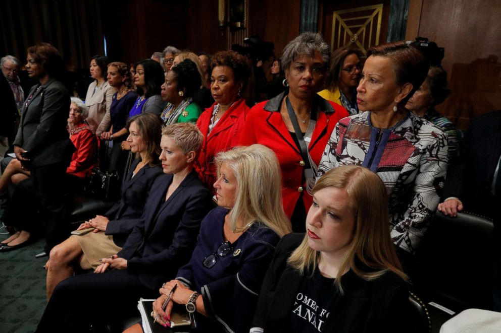 PHOTO: Female members of Congress stand in protest behind seated supporters of U.S. Supreme Court nominee Brett Kavanaugh, as members of the Senate Judiciary Committee meet to vote on Kavanaughs nomination on Capitol Hill in Washington, Sept. 28, 2018.