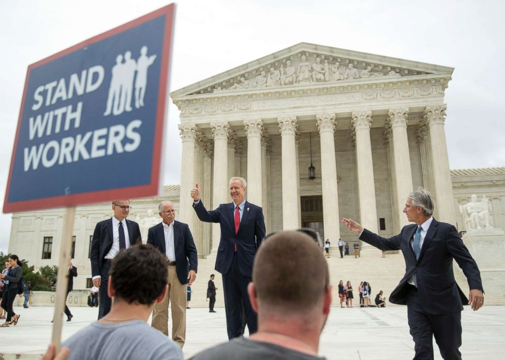 PHOTO: Jacob Huebert, Bruce Rauner, John Tillman, and plaintiff Mark Janus walk out of the the Supreme Court after the court rules in a setback for organized labor that states cant force government workers to pay union fees in Washington, June 27, 2018.