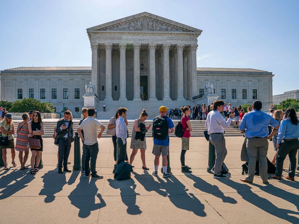 PHOTO: Visitors line up to enter the Supreme Court on Capitol Hill in Washington, June 24, 2019.