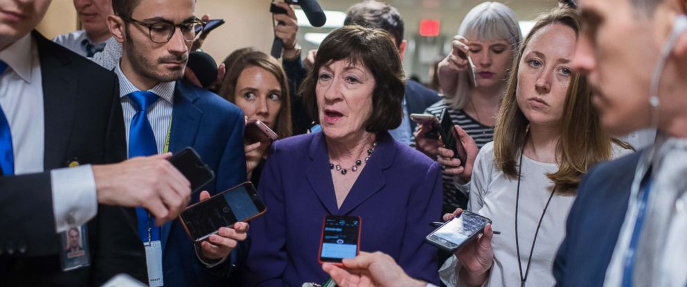 PHOTO: Sen. Susan Collins, R-Maine, talks with reporters in the Capitols Senate subway before the Senate Policy luncheons, June 19, 2018.