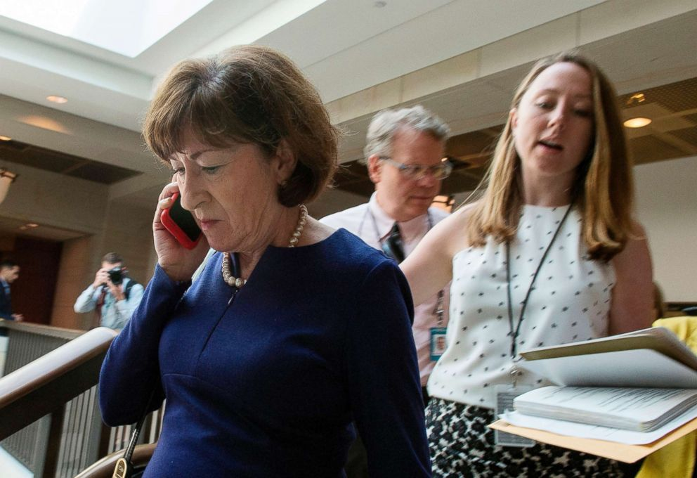 Republican of Maine speaks on her phone as she walks to a room to read the report on the FBI investigation into Supreme Court nominee Brett Kavanaugh on Capitol Hill in Washington on Oct. 4 2018