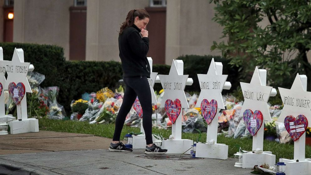 A woman reacts at a makeshift memorial outside the Tree of Life synagogue following Saturday's shooting at the synagogue in Pittsburgh, Oct. 29, 2018.