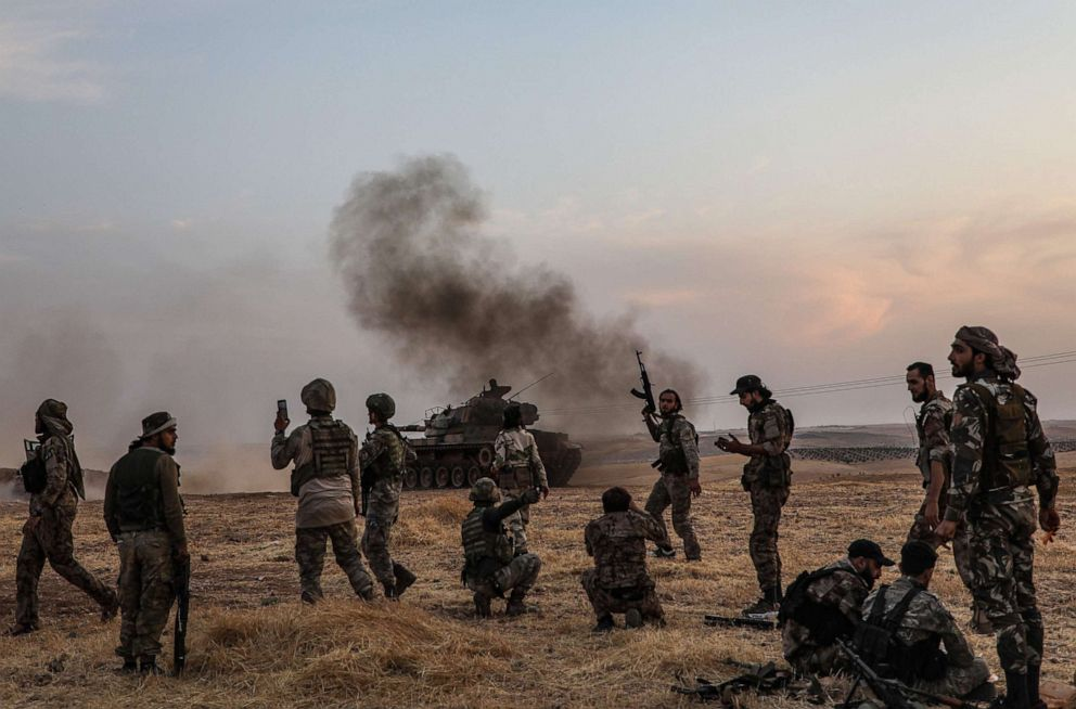PHOTO: Turkish soldiers and Turkey-backed Syrian fighters gather on the northern outskirts of the Syrian city of Manbij near the Turkish border, Oct. 14, 2019.