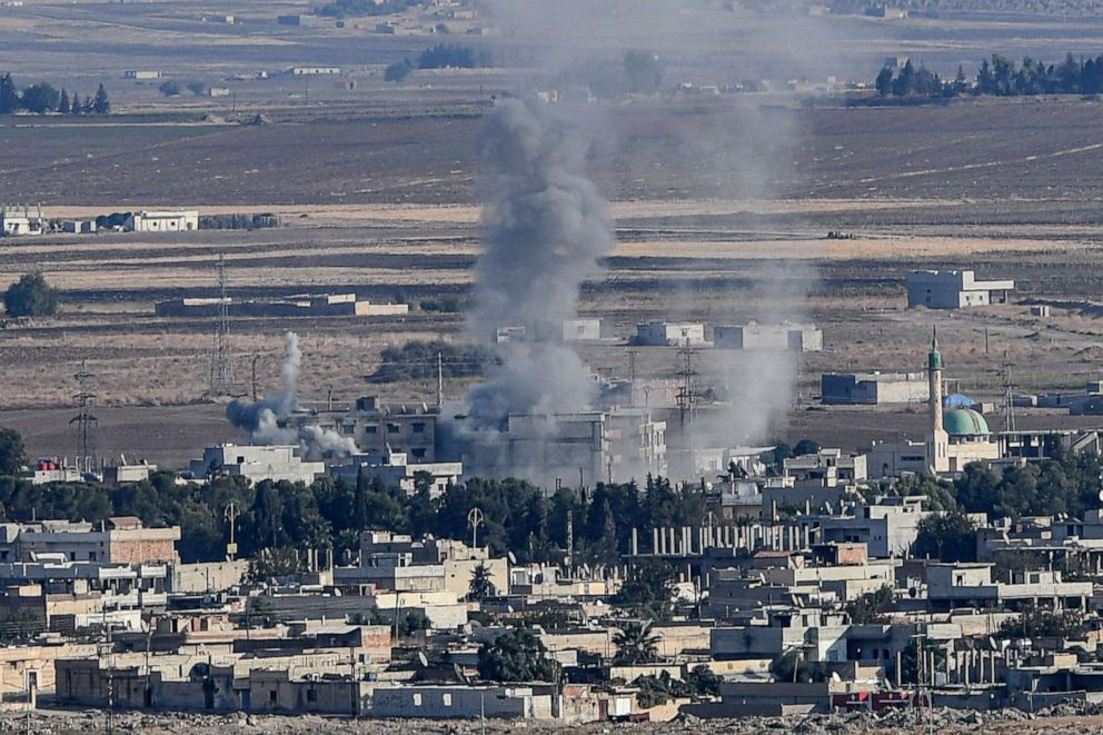 PHOTO: Smoke rises from the Syrian town of Ras al-Ain on the first week of Turkeys military operation against Kurdish forces, Oct. 15, 2019.