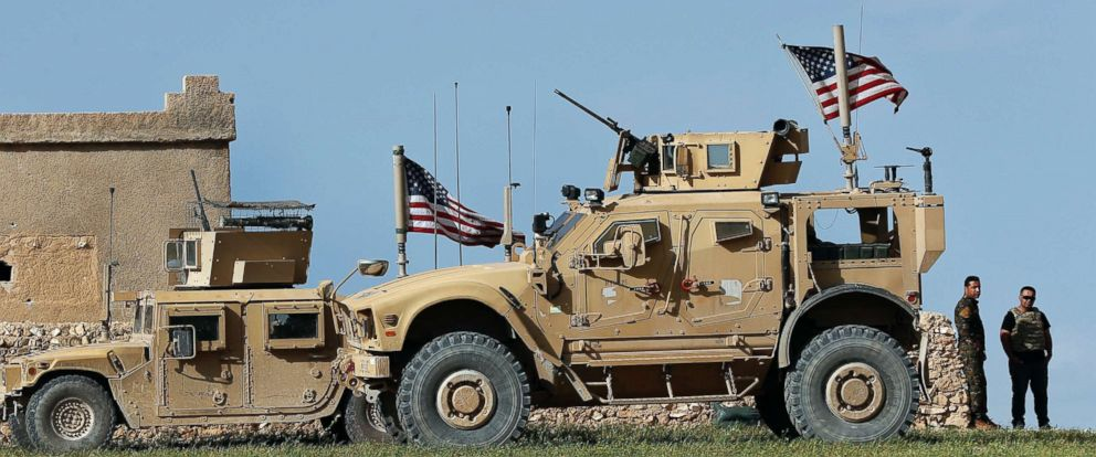 PHOTO: A U.S. humvee is pictured at a U.S. troops outpost on a road leading to the tense front line between Syrian Manbij Military Council fighters and Turkish-backed fighters, March 29, 2018, at Halawanji village, north of Manbij town, Syria