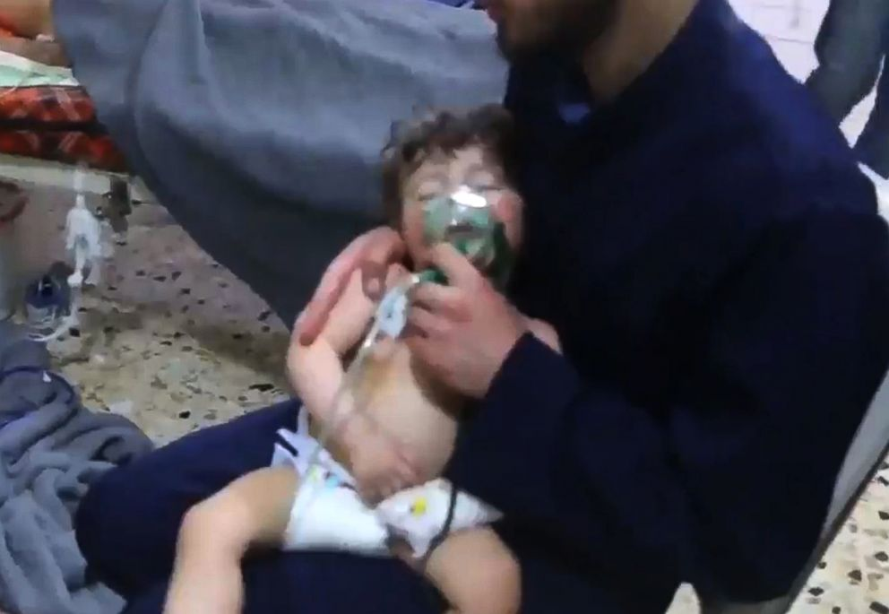 PHOTO: An image grab taken from a video released by the Syrian civil defense in Douma shows an unidentified volunteer holding an oxygen mask over a childs face at a hospital following a reported chemical attack on the rebel-held town, April 8, 2018.