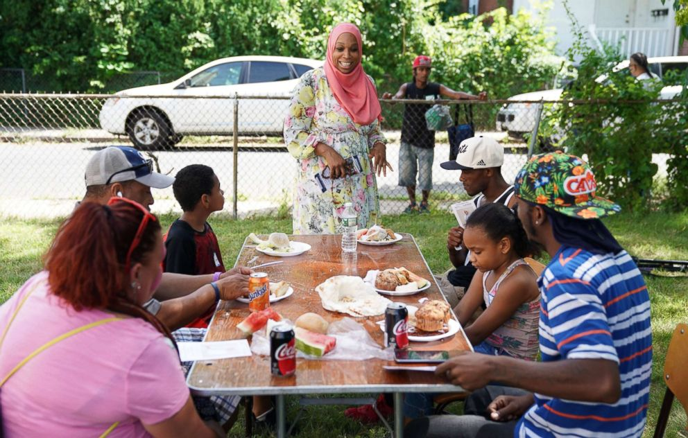 Tahirah Amatul-Wadud, who is running in the Democratic primary for U.S. Congress in Massachusetts, meets with people at a Mt. Zion Church event in Chicopee, Mass., July 21, 2018.