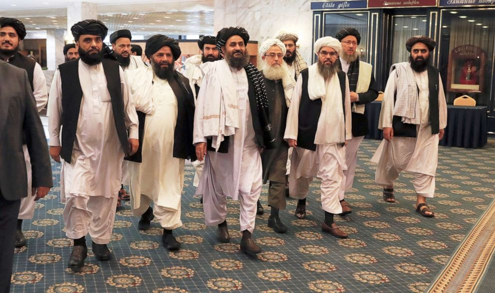 PHOTO: Members of a Taliban delegation, led by chief negotiator Mullah Abdul Ghani Baradar (C, front), walk before a meeting with Afghan senior politicians in Moscow, Russia, May 30, 2019.