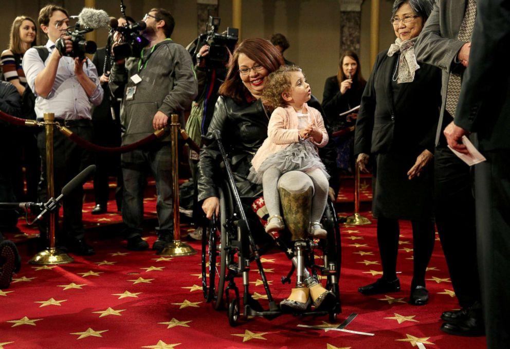PHOTO: Sen. Tammy Duckworth carries her daughter Abigail in Washington, Jan. 3, 2017.