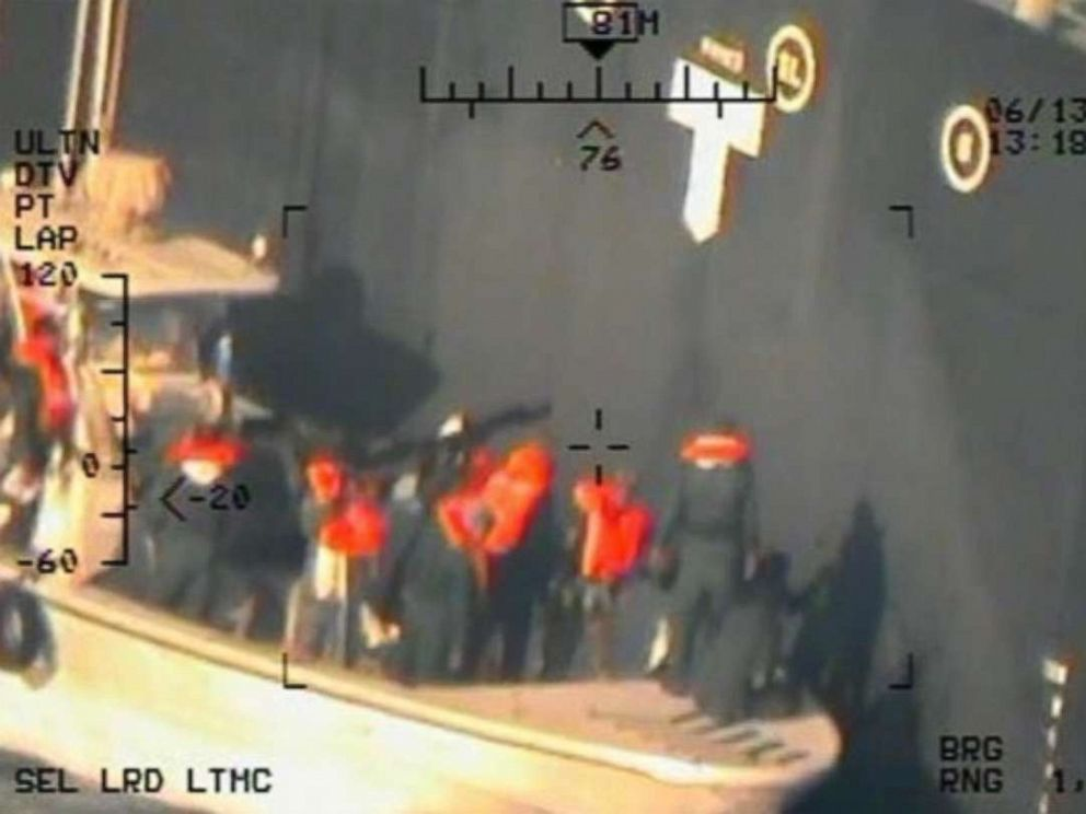 PHOTO: Imagery taken from a U.S. Navy MH-60R helicopter of the Islamic Revolutionary Guard Corps Navy removing an unexploded limpet mine from the M/T Kokuka Courageous.
