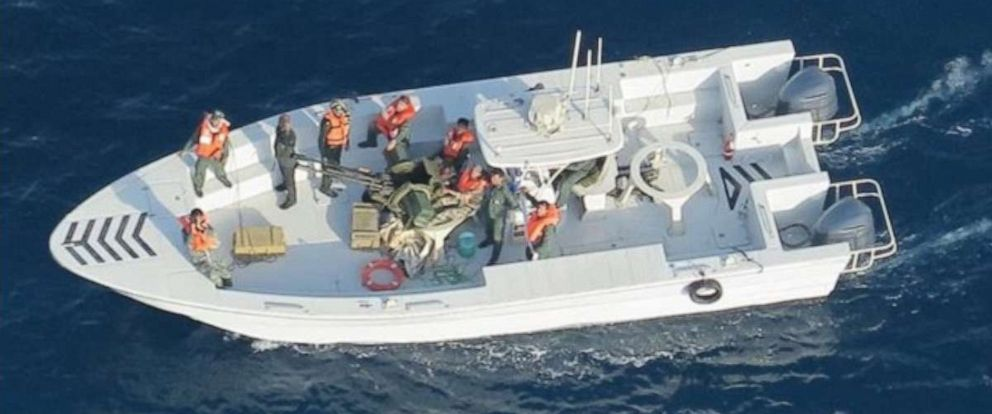 PHOTO: Imagery taken from a U.S. Navy MH-60R helicopter of the Islamic Revolutionary Guard Corps Navy after removing an unexploded limpet mine from the M/T Kokuka Courageous.