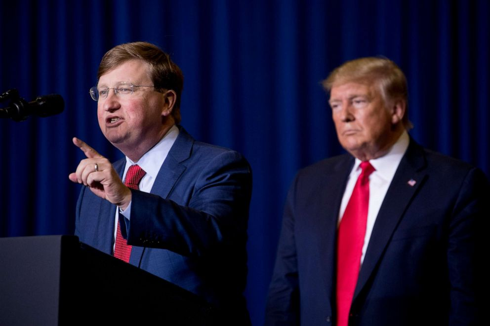 PHOTO: Mississippi Lt. Gov. Tate Reeves, left, accompanied by President Donald Trump speaks at a rally at BancorpSouth Arena in Tupelo, Miss., Nov. 1, 2019.
