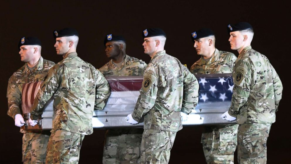 An Army carry team moves a transfer case containing the remains of Maj. Brent R. Taylor at Dover Air Force Base, Del., Nov. 6, 2018. According to the Department of Defense, Taylor, 39, of Ogden, Utah, died Nov. 3, 2018, in Kabul province, Afghanistan, of wounds sustained from small arms fire.