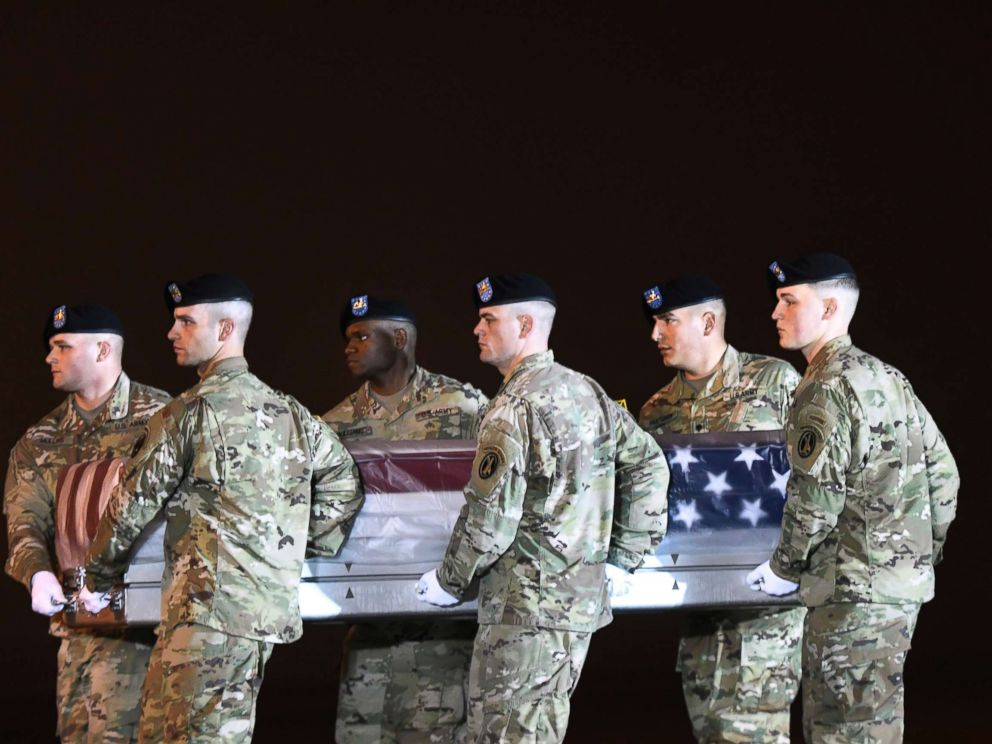 PHOTO: An Army carry team moves a transfer case containing the remains of Maj. Brent R. Taylor at Dover Air Force Base, Del., Nov. 6, 2018.
