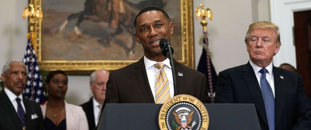 PHOTO: Johnny C. Taylor Jr. (L) speaks as President Donald Trump (R) listens during an announcement in the Roosevelt Room of the White House, Feb. 27, 2018.