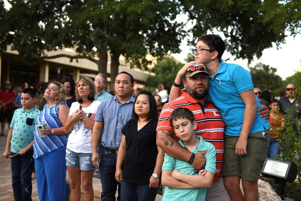 PHOTO: People gather for a vigil following Saturdays shooting in Odessa, Texas, Sept. 1, 2019.