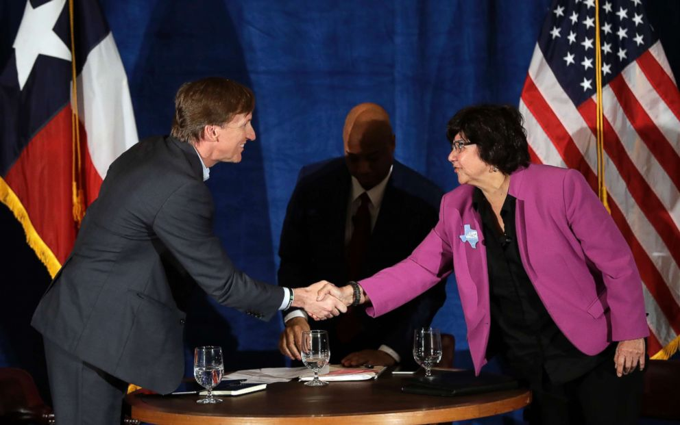 Texas Democratic gubernatorial candidates Andrew White, left, and Lupe Valdez, right, shake hands following their debate, May 11, 2018, in Austin, Texas.