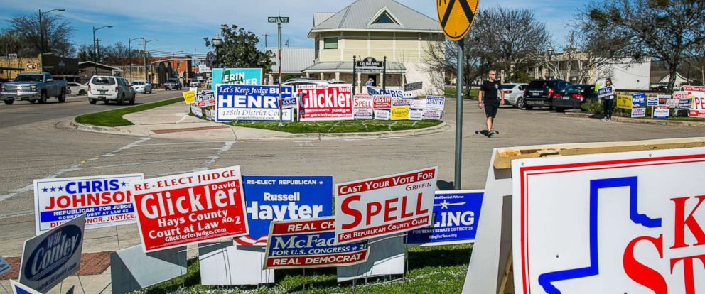 PHOTO: Voters maneuver the signage outside Buda City Hall as Texans go to the polls for the nations first primary of 2018 on March 6, 2018 in Buda, Texas.