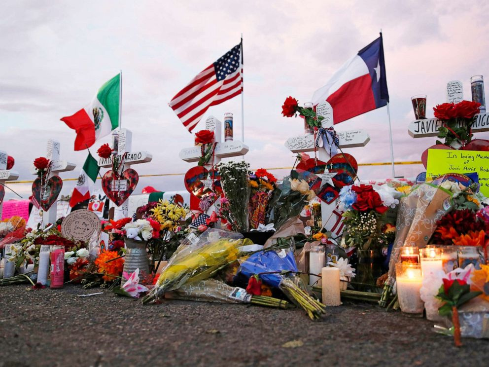 PHOTO: Flags hover over crosses at a makeshift memorial reach the scene of a mass taking pictures at a browsing complex Tuesday, Aug. 6, 2019, in El Paso, Texas.