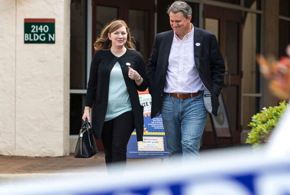 PHOTO: Lizzie Pannill Fletcher, a Democrat running for the 7th Congressional District seat in the U.S. House of Representatives, and her husband, Scott Fletcher, after voting in the primary election in Houston, March 6, 2018.