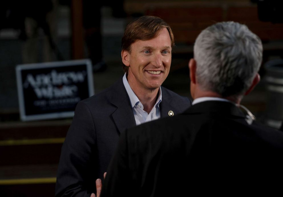 PHOTO: Andrew White, left, a Democratic candidate for governor, talks to a television reporter before an election watch party at Raven Tower in Houston, March 6, 2018.
