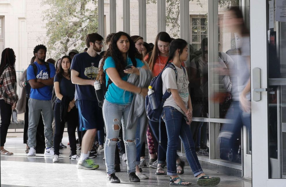 PHOTO: A line of mostly students wait to vote at a Texas primary election polling site on the University of Texas campus, March 6, 2018, in Austin, Texas.