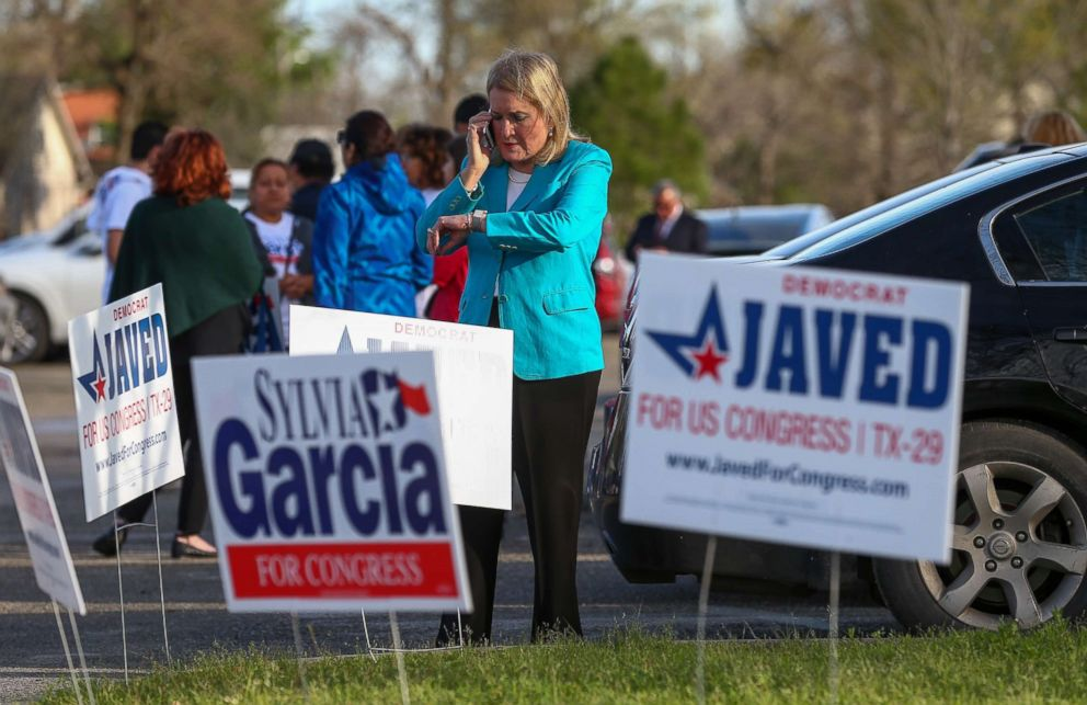 PHOTO: Senator Sylvia Garcia tries to reach officials to fix polling machines and allow constituents to vote at the Montie Beach Community Center on March 6, 2018, in Houston.