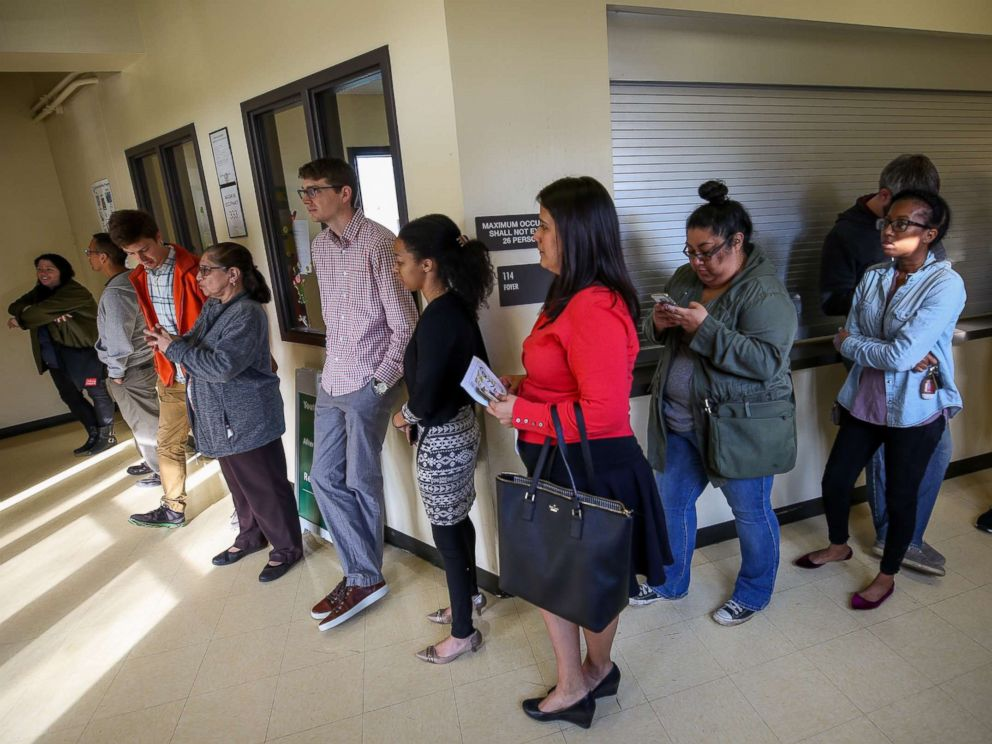 PHOTO: People wait in line to vote as officials work to resolved issues with polling machines at the Montie Beach Community Center on March 6, 2018, in Houston.