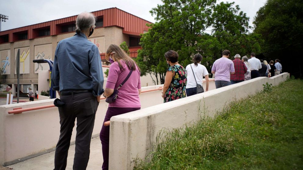 PHOTO: Austin, Texas residents line up in record numbers, April 27, 2021, for early voting on municipal issues.