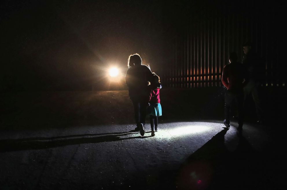 PHOTO: A Honduran mother walks with her children next to the U.S.-Mexico border fence as they turned themselves in to Border Patrol agents on February 22, 2018 near Penitas, Texas.
