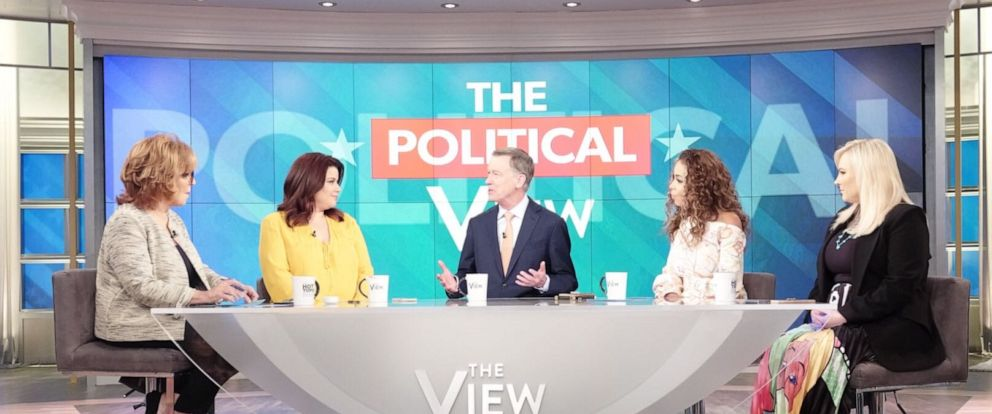 """PHOTO: Former Colorado Gov. John Hickenlooper (seated in the center) discusses the state of the Democratic Party and his presidential campaign on """"The View."""""""