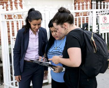 PHOTO: Tiffany Caban consults her campaign team while canvassing for votes in Queens, New York, June 21, 2019.