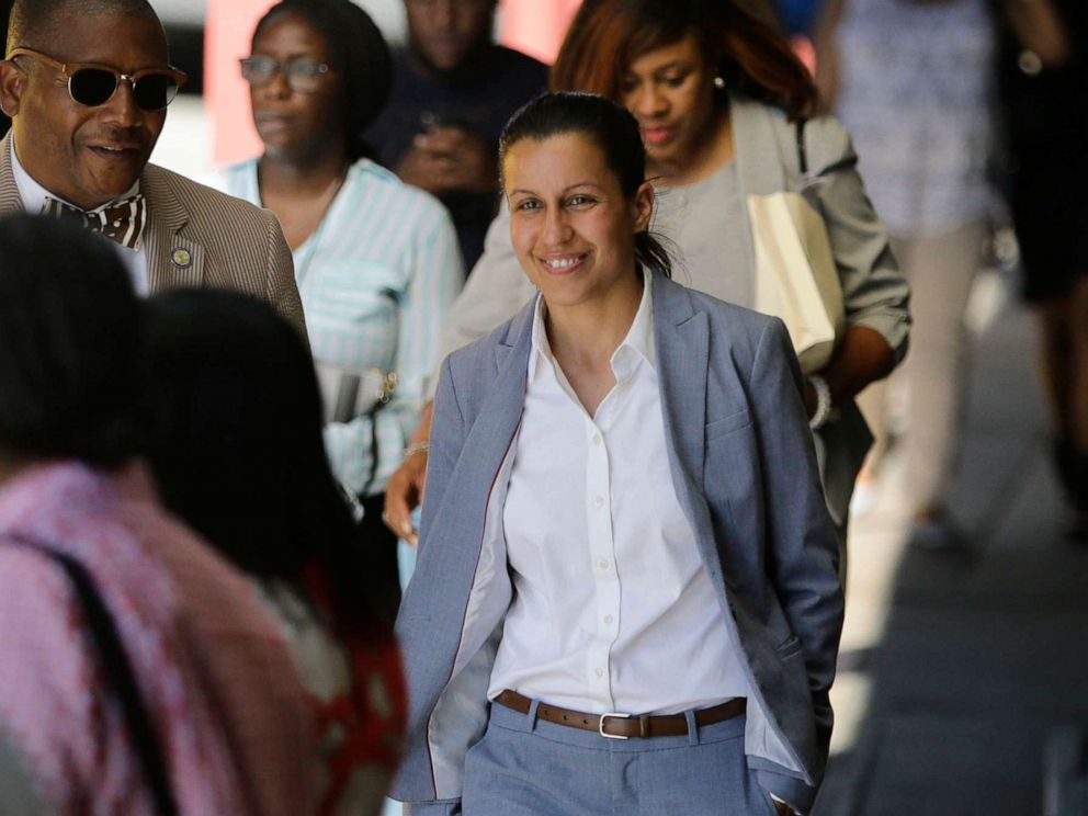 PHOTO: Queens district attorney candidate Tiffany Caban walks among commuters Wednesday, June 26, 2019, in the Queens borough of New York
