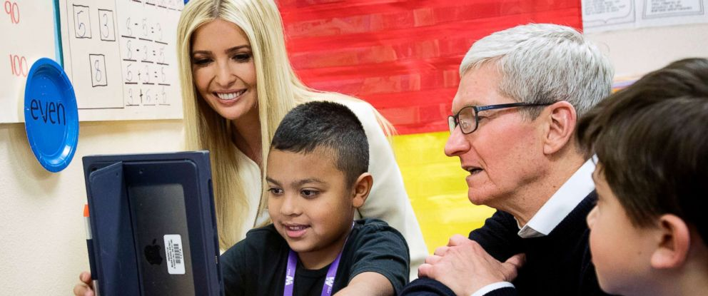 PHOTO: Apple CEO Tim Cook, right, and Ivanka Trump, daughter and adviser to President Donald Trump, talk with first-grader Israel Perez about work hes doing on his iPad in Boise Idaho, Nov. 27, 2018.