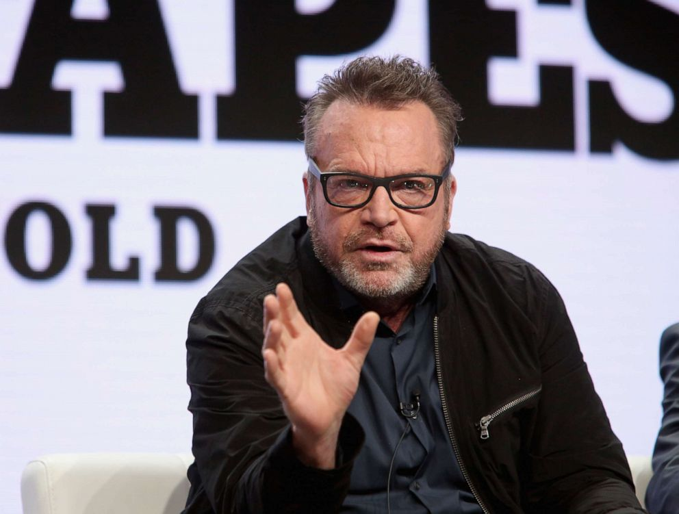 PHOTO: Tom Arnold discusses The Hunt For The Trump Tapes onstage during The 2018 Summer Television Critics Association Press Tour on July 26, 2018, in Los Angeles.
