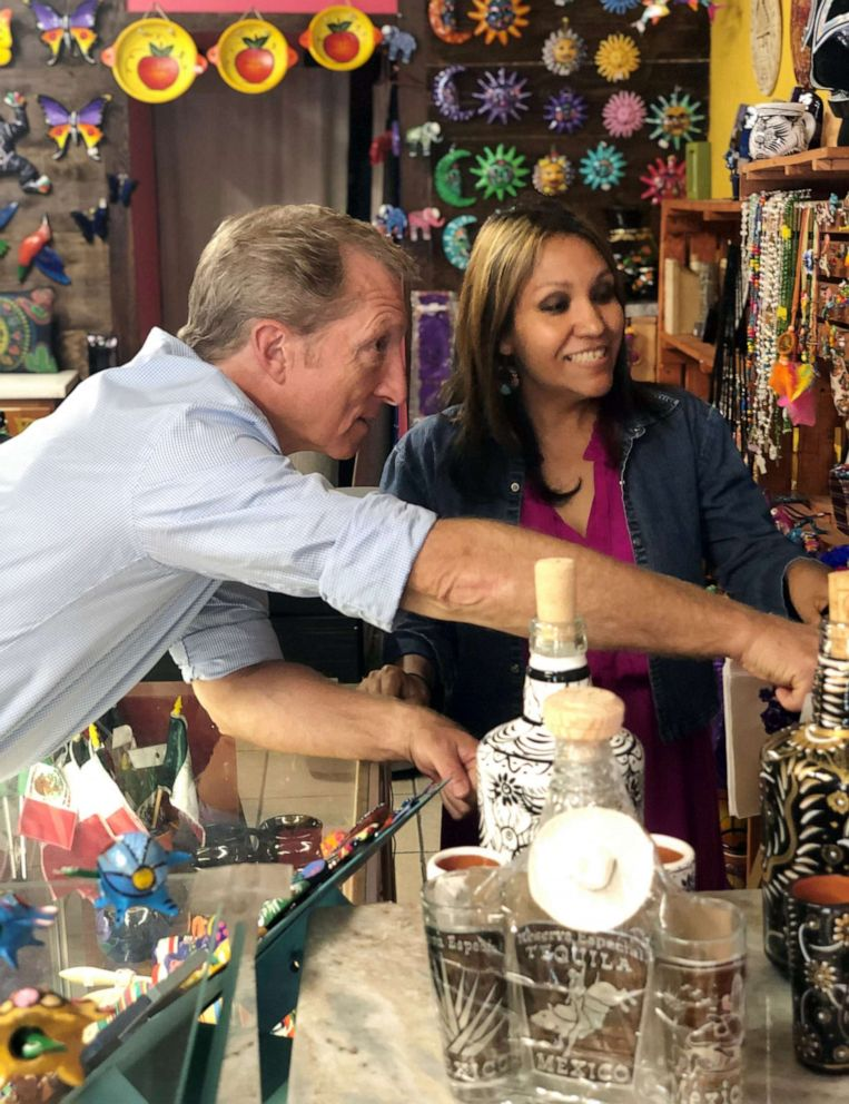 PHOTO: Tom Steyer chats with Eva Herandez, owner of Chocolate Arts & Crafts, which sells handmade Mexican jewelry, at a campaign stop in South Philadelphia, September 18, 2019.