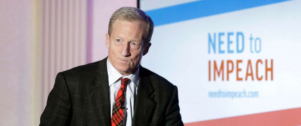 """PHOTO: Billionaire investor and Democratic activist Tom Steyer steps on a stage at the start of a """"Need to Impeach"""" town hall event, March 13, 2019, in Agawam, Mass."""