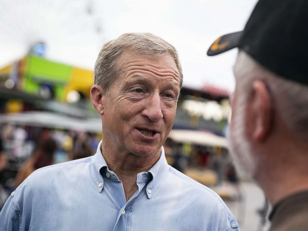 PHOTO: Tom Steyer, a businessman and 2020 presidential candidate, greets an attendee during the Iowa State Fair in Des Moines, Iowa, Aug. 11, 2019.