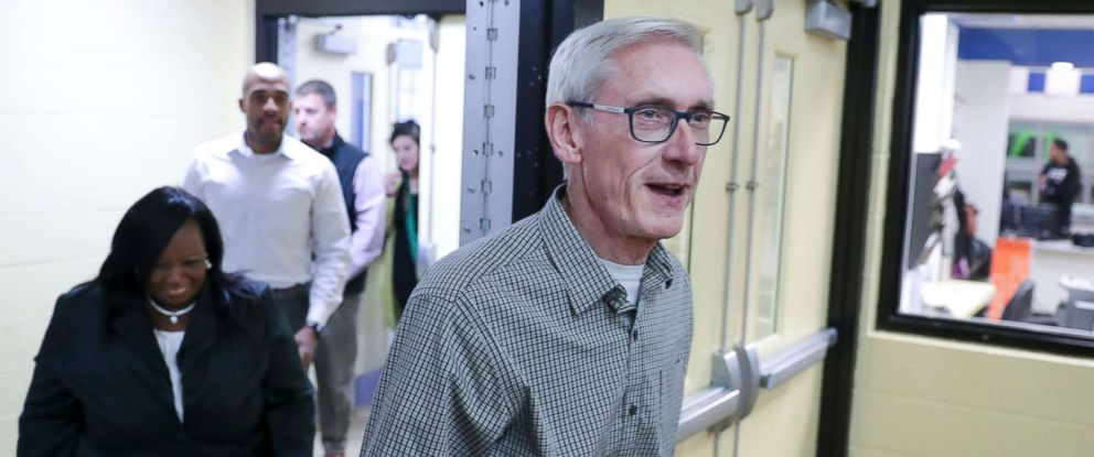 PHOTO: Governor-elect Tony Evers walks into a room filled with press before making a statement, and answering questions on Wednesday Nov. 7, 2018.