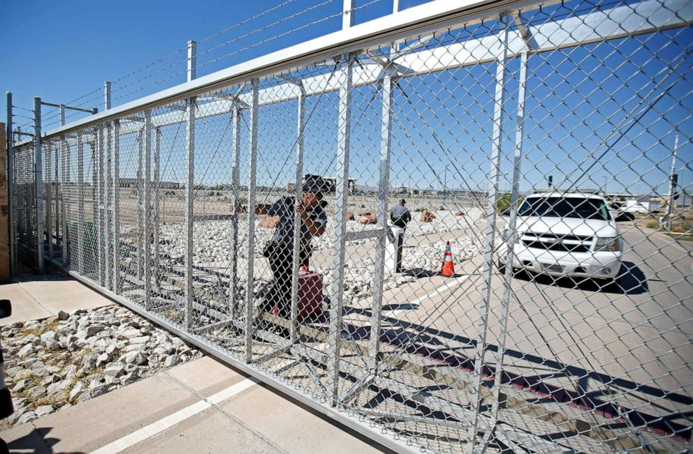 PHOTO: An agent with the Department of Homeland Security closes the exterior gate of the holding facility for immigrant children in Tornillo, Texas, near the Mexican border, June 12, 2018.