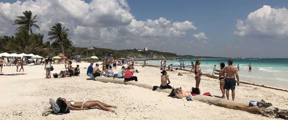 PHOTO: Tourists enjoy the beach in Tulum National Park, Quintana Roo state, Mexico on March 23, 2017.
