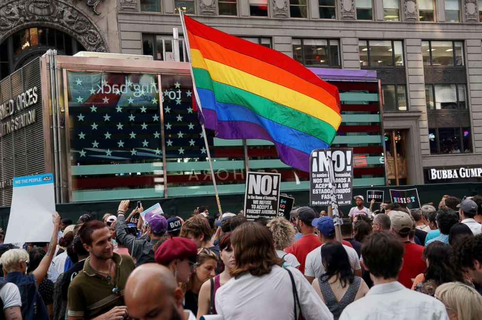 A rainbow flag flies in Times Square, July 26, 2017, in New York, as people protest President Donald Trump's announcement that he plans to reinstate a ban on transgender individuals from serving in any capacity in the U.S. military.