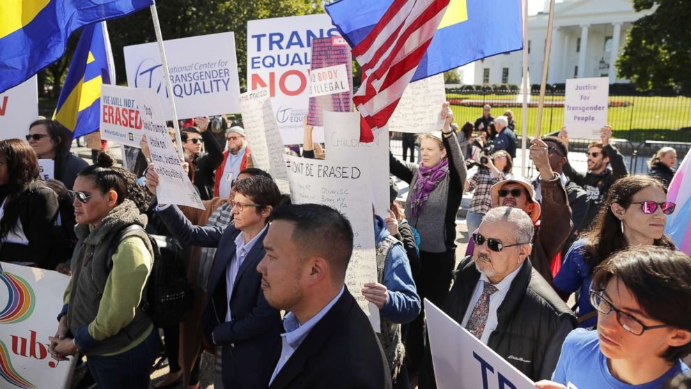 LGBT activists from the National Center for Transgender Equality, partner organizations and their supporters hold a rally in front of the White House, Oct. 22, 2018.