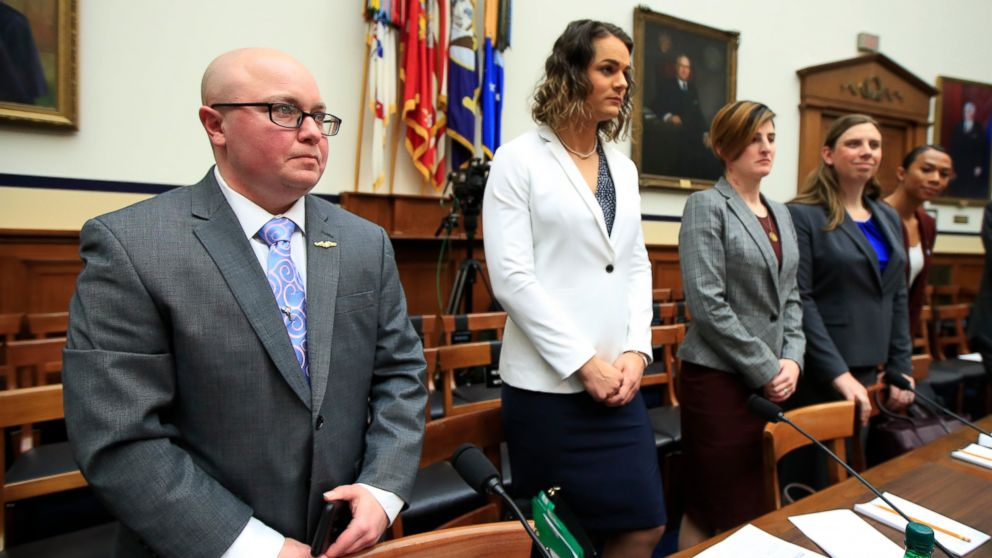 In this Feb. 27, 2019, file photo, from left, transgender military members Navy Lt. Cmdr. Blake Dremann, Army Capt. Alivia Stehlik, Army Capt. Jennifer Peace, Army Staff Sgt. Patricia King and Navy Petty Officer Third Class Akira Wyatt, listen before the start of a House Armed Services Subcommittee on Military Personnel hearing on Capitol Hill in Washington.