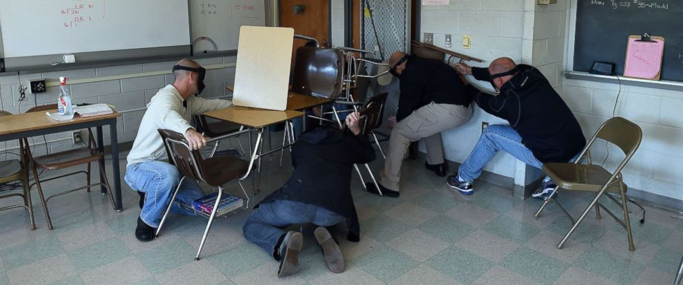 "PHOTO: ""Students"" participating in a training session, barricade a door of a classroom to block an ""active shooter"" during ALICE (Alert, Lockdown, Inform, Counter and Evacuate) at the Harry S. Truman High School in Levittown, Pennsylvania, Nov. 3, 2015."