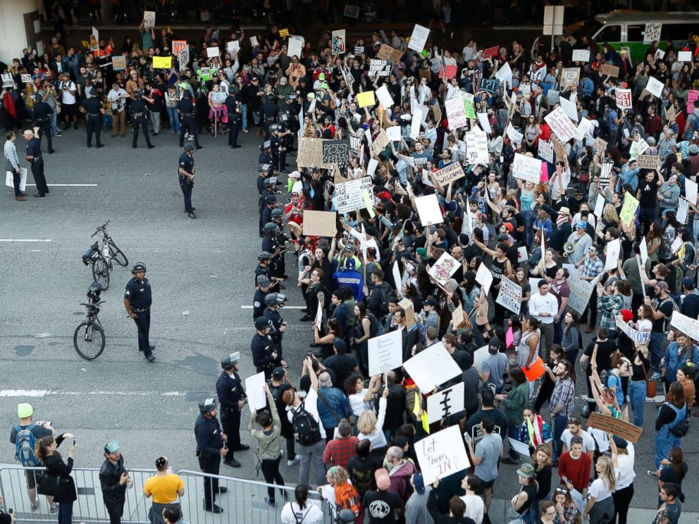 PHOTO: Police officers block demonstrators from marching on the lower roadway during a protest against President Donald Trumps executive order banning travel from seven Muslim-majority countries, at Los Angeles International Airport on Jan. 29, 2017.
