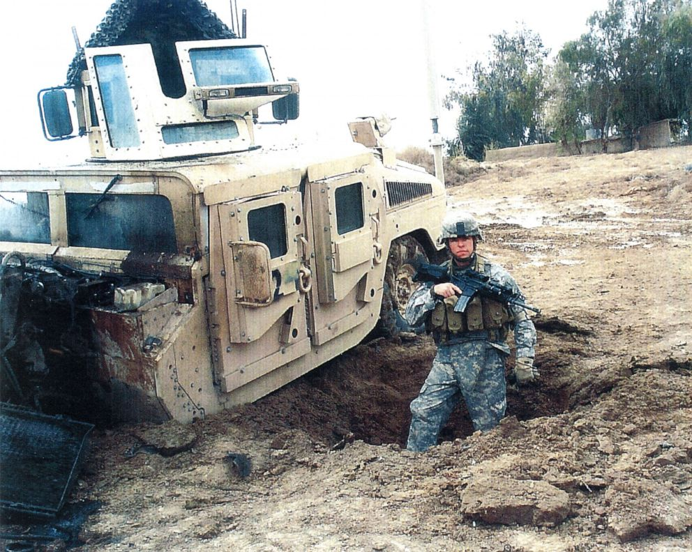 PHOTO: Sgt. Travis Atkins stands next to his vehicle after it was damaged by an improvised explosive devise in Iraq during 2007.