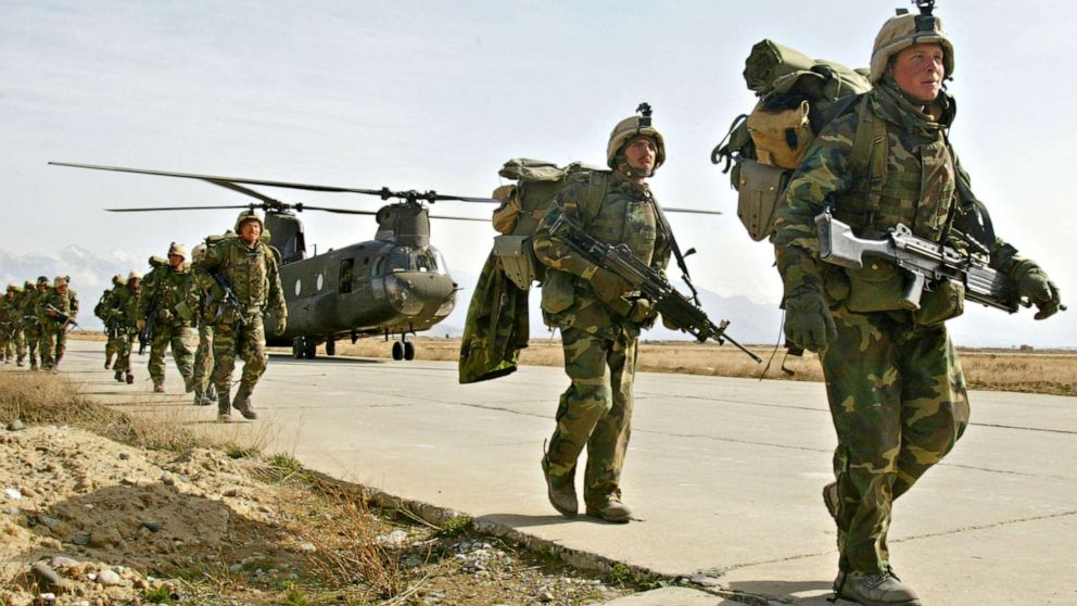 PHOTO: U.S. Army soldiers from the 10th Mountain and the 101st Airborne units disembark from a Chinook helicopter March 11, 2002 as they return to Bagram airbase from the fighting in eastern Afghanistan.
